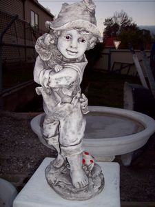 Concrete Figurine of a little boy holding a dog