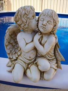 Concrete Figurine of a Boy Kissing Girl Angels